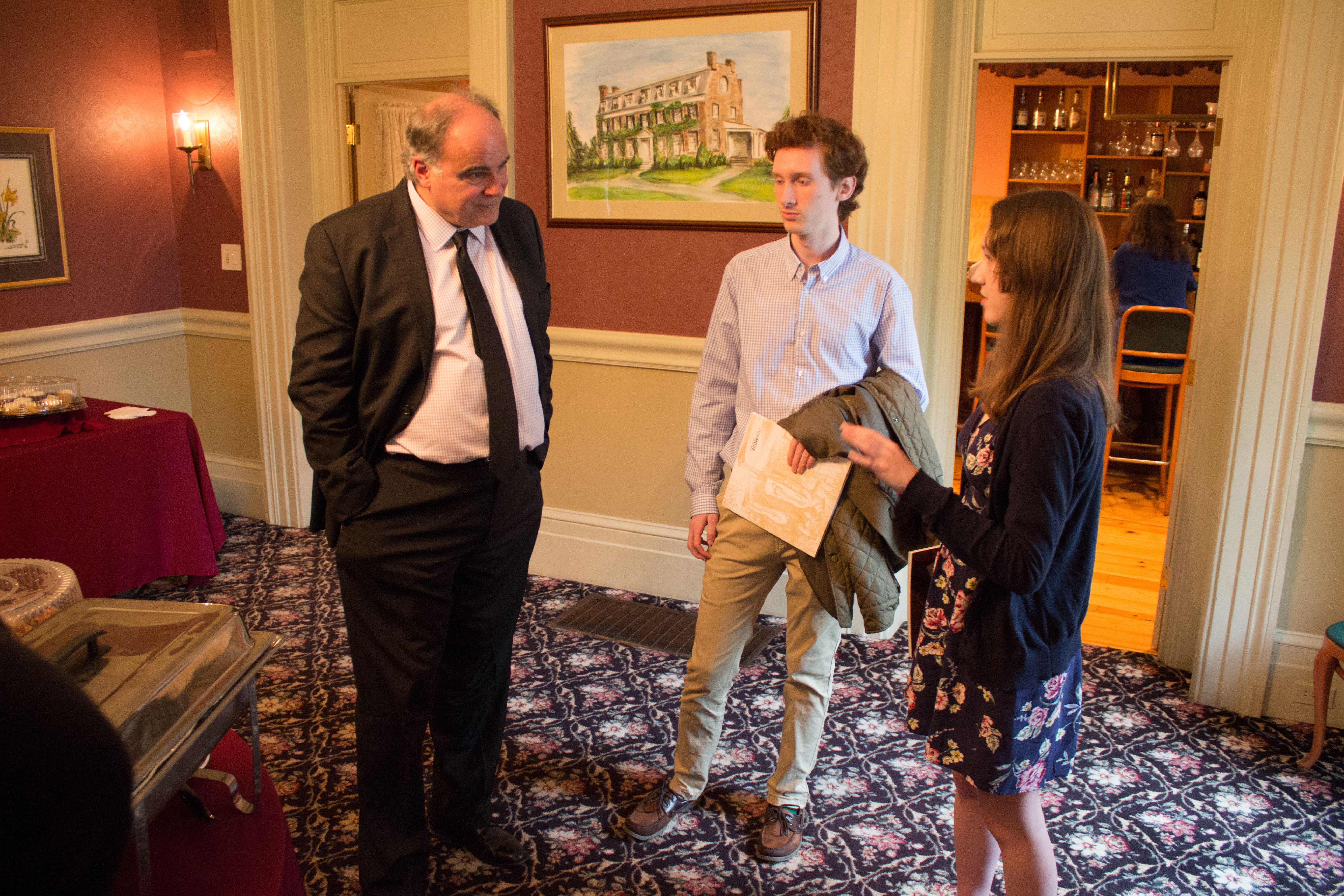 AHI President Robert Paquette with Cas Zablotski and Canisius student Charlotte Kacprowicz